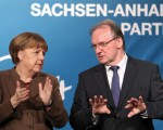 Angela Merkel's conservatives lose two major regional elections