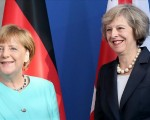 UK's May warns Russia of further sanctions over Syria