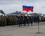 Putin orders withdrawal of Russian troops on surprise Syria visit